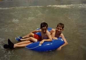 Vance & Adam in inner tube at beach